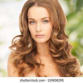 health and beauty, eco, bio, nature concept - face of beautiful woman with long hair over green background