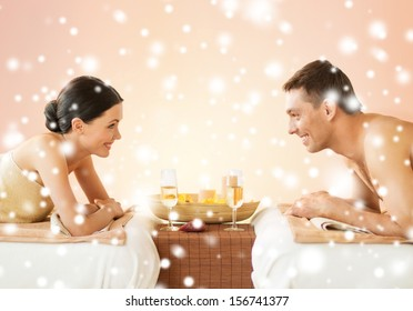 health and beauty, honeymoon and vacation concept - couple in spa salon drinking champagne