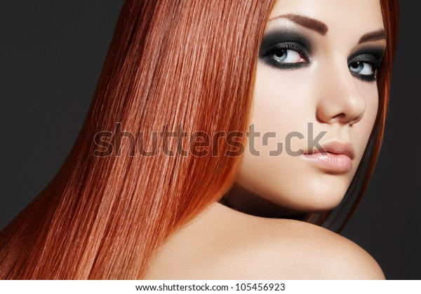 Health, beauty, wellness, haircare, cosmetics and make-up. Beautiful fashion hairstyle. Woman model with shiny straight long hair and evening make-up