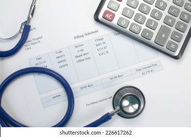 Health care billing statement with stethoscope and calculator.