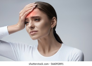 Health Care. Closeup Of Beautiful Young Woman Suffering From Terrible Strong Head Pain, Touching Her Face. Tired, Exhausted Female Feeling Stress And Having Painful Migraine, Headache. High Resolution