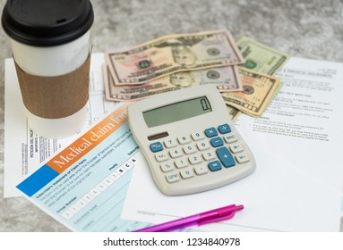 health care concept. medicare changes. insurance claim forms, choices, premiums, calculator and money