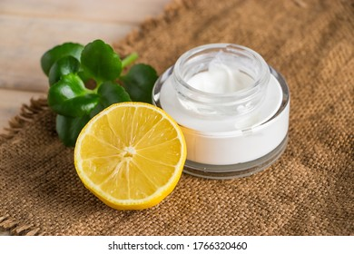 Health care concept. Organic cosmetics with lemon. Natural moisturizer on a wooden background.