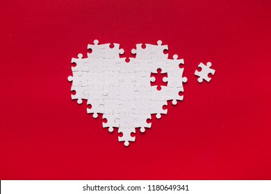 Health care concept. Puzzle heart with one piece missing. Heart vitamines add