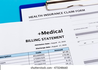 Health care cost concept with medical bill and health insurance claim form
