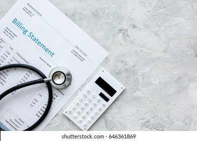 health care costs with billing statement, stethoscope and calculator on stone table top view mockup