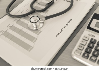 Health care costs concept picture : Stethoscope and calculator on a medical chart ,symbol for health care costs or medical insurance in color tone.