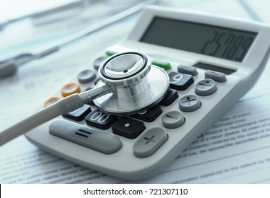 health care costs or medical savings concept. stethoscope on calculator with medical billing.