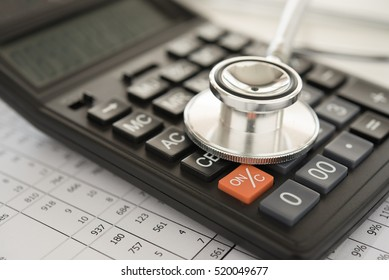 health care costs,  stethoscope and calculator on bills for finance plan or health insurance.