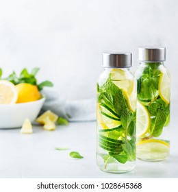 Health care, fitness, healthy nutrition diet concept. Fresh cool lemon cucumber mint infused water, cocktail, detox drink, lemonade in a glass jar for spring summer days. Light background
