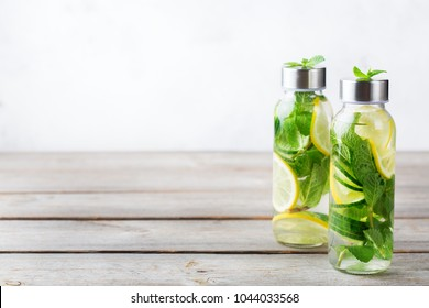 Health care, fitness, healthy nutrition diet concept. Fresh cool lemon cucumber mint infused water, cocktail, detox drink, lemonade in a glass jar for spring summer days. Copy space background