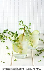 Health care, fitness, healthy nutrition diet concept. Fresh cool lemon thyme infused water, cocktail, detox drink