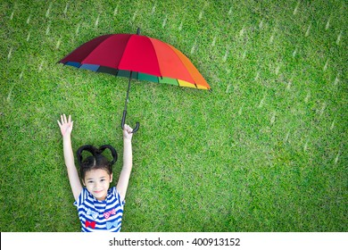 Health care insurance concept for family and children medical healthcare protection, flu prevention immunization with happy asian school girl kid holding umbrella under the rain on green lawn