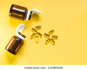 health care and medical concept from minimal flat lay of amber glass reagent bottle with pill and vitamin arrange look like human and put on yellow pastel background