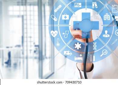 Health care and medical services concept with circular AR interface and female doctor using stethoscope