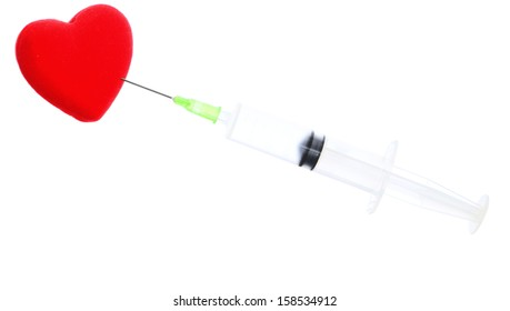 Health care and medical theme - syringe and red heart isolated on white