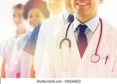 health care, profession, people and medicine concept - close up of happy doctors with stethoscope at hospital