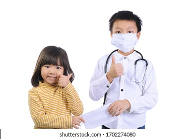 Health care and Protection Coronavirus concept. A boy in medical mask sending a self-protect mask for a little cute girl and showing thumbs up gesture good for health on isolate in white background.