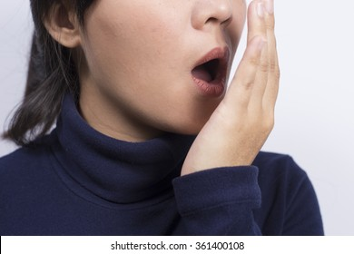 Health Care: Woman checking her breath with her hand