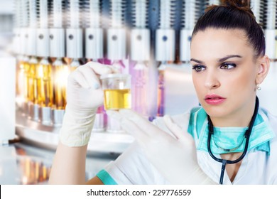Health care worker holding a urine sample in the front of the medical vials