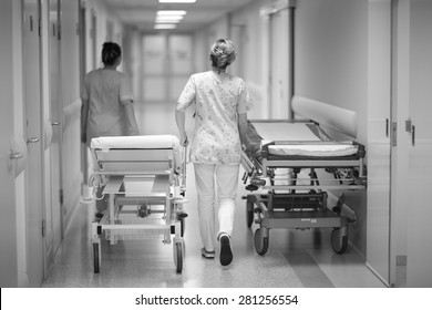 Health care worker's transporting emergency beds