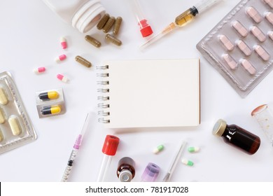 Health care,medical theme and concept. Painkillers, pills, microscope, drug development. Drug prescription for treatment medication. Pharmaceutical medicament with notebook. Copy space for your text.