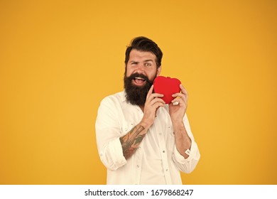 Health Check helps understand risk factors for heart disease and estimate how likely have attack or stroke next years. Man bearded hipster hold red heart toy. Medicine concept. Listen to your heart.