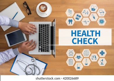 HEALTH CHECK  Professional doctor use computer and medical equipment all around, desktop top view, coffee