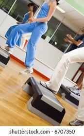 health club: group of people doing aerobics