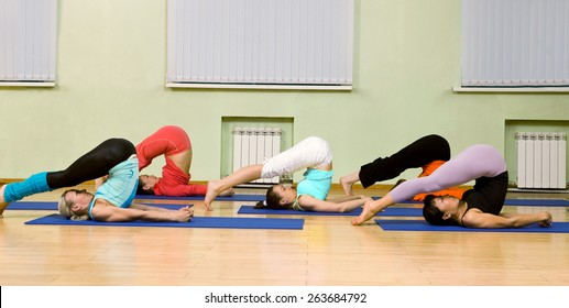 Health Club: Women of Different Age (from 18 to 50) Practicing Yoga in the Gym. in the Gym
