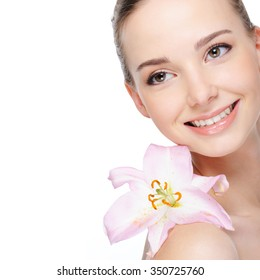 health complexion of beautiful happy laughing young woman with lily on her shoulder