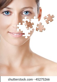 Health concept image - Beautiful young woman with puzzle pieces