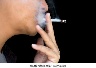 Health Concept Unidentified man smoking a cigarette