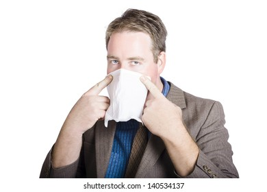 Health conscious business man covering face with tissue to prevent the spread of airborne bacteria. contagious diseases.
