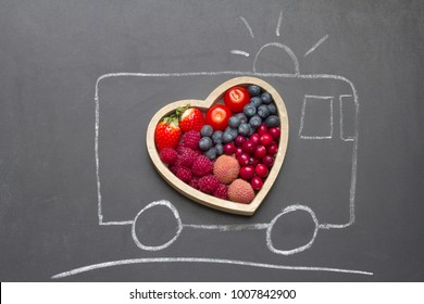 Health diet heart abstract concept with rescue ambulance on blackboard