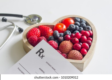 Health diet with heart stethoscope and medical prescription concept