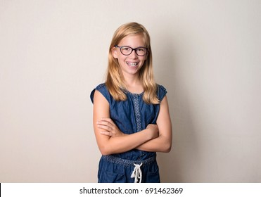 Health, education and people concept. Happy teen girl in braces and eyeglasses isolated.