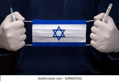 Health employee doctor holding syringe, mercury thermometer and medical face mask with Israel flag. Coronavirus (COVID-19) pandemic affects the country.