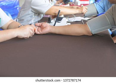 Health examination, blood pressure measurement.