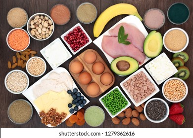 Health food for body builders with high protein lean meat, dairy, dietary supplement powders, pulses, seeds, nuts, grains, cereals, fruit and vegetables.