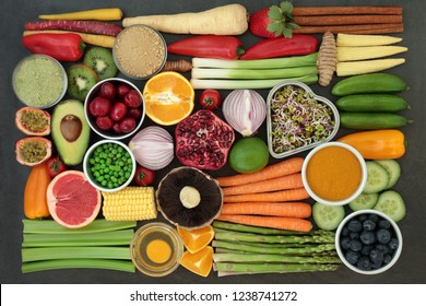 Health food for clean eating concept with fresh fruit, vegetables, dairy, supplement powders, herbs and spices.  High in antioxidants, anthocyanins, vitamins and dietary fibre. Flat lay.