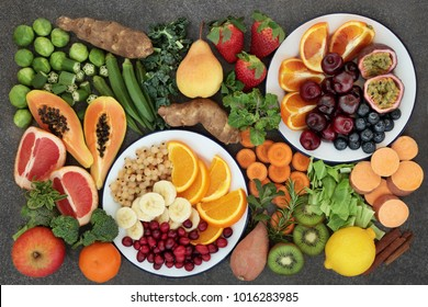 Health food concept for a high fibre diet with fresh fruit and vegetables very high in anthocyanins, antioxidants and vitamins on marble background top view.