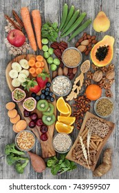 Health food concept for a high fibre diet with fruit, vegetables, cereals, nuts, seeds, whole wheat pasta, grains, legumes and spice. Foods high in omega 3, anthocyanins and antioxidants,  top view.