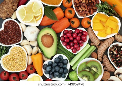 Health food for fitness conceptwith immune boosting properties with fruit, vegetables, herbs, spice, grains, pulses. High in anthocyanins, antioxidants, smart carbs, omega 3, minerals, vitamins.