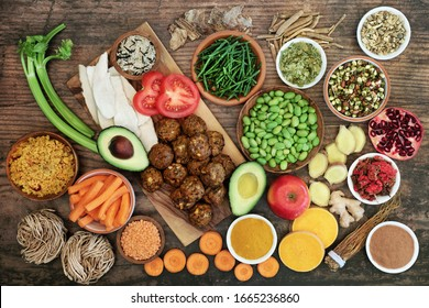 Health food for a healthy diet with foods high in protein, antioxidants, anthocyanins, vitamins, minerals, smart carbs, omega 3 and fiber. Flat lay on rustic wood background.