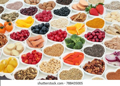 Health food for a healthy heart concept with vegetables, fruit, fish, nuts, seeds, supplement powders, pulses, cereals and herbs used in herbal medicine. High in omega 3,  fibre & antioxidants.