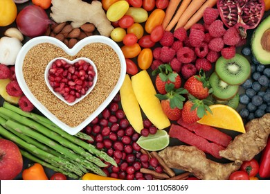 Health food for heart fitness with seeds, vegetables, fruit, nuts, herbs and spice. Super food concept high in omega 3 fatty acid, anthocyanins, fibre antioxidants, minerals and vitamins.