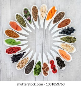 Health food to improve brain power concept with nuts, seeds, medicinal herbs, pollen grain, vegetables and fruit. Super foods high in minerals, vitamins, antioxidants and anthocyanins. Top view.