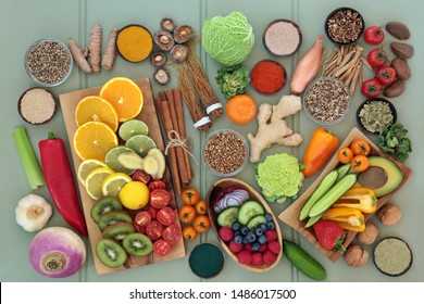 Health food for liver detox concept with fresh fruit, vegetables, nuts, seeds, supplement powders with herbs and spices used in herbal medicine. Foods high in antioxidants, vitamins & dietary fibre.