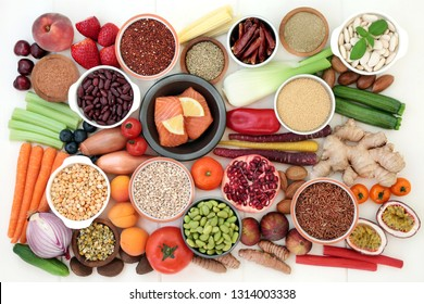 Health food for losing weight with fish, legumes, fresh fruit and vegetables, grains, nuts, supplement powders, herbs and herbal medicine used to help weight loss. Top view.